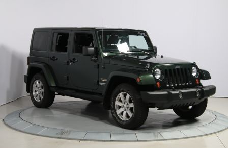 2012 Jeep Wrangler Sahara 4WD A/C GR ELECT 2TOITS MAGS in Brossard